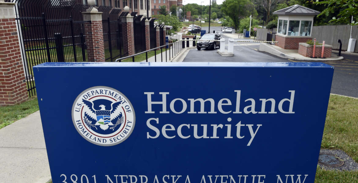FILE - In this June 5, 2015, file photo, a gate leading to the Homeland Security Department headquarters in northwest Washington. Hackers stole personnel data and Social Security numbers for every federal employee, a government worker union said Thursday, June 11, 2015, charging that the cyberattack on U.S. employee data is far worse than the Obama administration has acknowledged. (AP Photo/Susan Walsh, File)