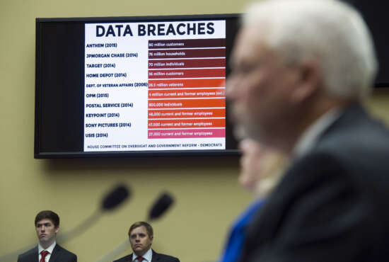 A chart of data breaches is shown on Capitol Hill in Washington, Tuesday, June 16, 2015, as witnesses testify before the House Oversight and Government Reform committee's hearing on the Office of Personnel Management (OPM) data breach. (AP Photo/Cliff Owen)