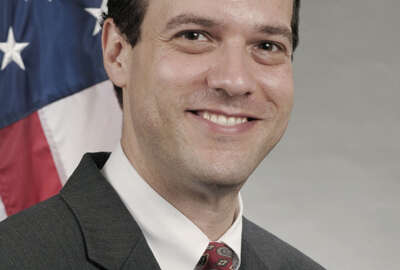 Headshot of Simon Szykman