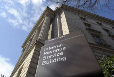 FILE - In this photo March 22, 2013 file photo, the exterior of the Internal Revenue Service (IRS) building in Washington. The IRS provided poor customer service during this year's tax filing season as taxpayers struggled with a rise in identity theft and complications related to President Barack Obama's health law, a government watchdog said Wednesday. A new report by the National Taxpayer Advocate says the IRS has been hampered by budget cuts. (AP Photo/Susan Walsh, File)