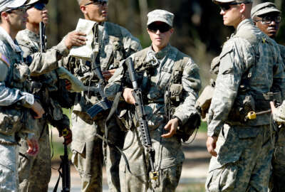 In this photo taken on Aug. 4, 2015, a female Army Ranger stands with her unit during Ranger School at Camp Rudder on Eglin Air Force Base, Fla. According to the Northwest Florida Daily News, she and one other female were the first to complete Ranger training and earn their Ranger tab this week. (Nick Tomecek/Northwest Florida Daily News via AP) MANDATORY CREDIT