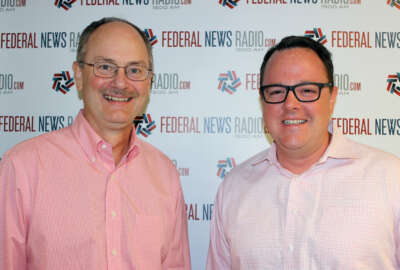 Roger Baker, left, former CIO at Veterans Affairs, and Tim Young, principal at Deloitte Digital, count down the week's top federal stories with Francis Rose. (Photo by Michael O'Connell/Federal News Radio)