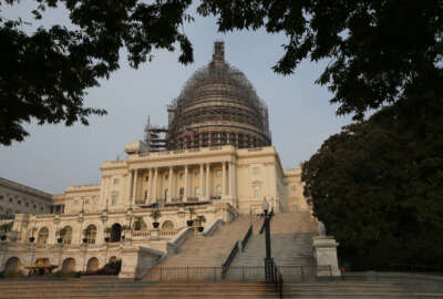 The west front of the U.S. Capitol is seen under repair Sept. 2, 2015 in Washington. Congress returns on Sept. 8 with a critical need for a characteristic that has been rare through a contentious spring and summer _ cooperation between Republicans and President Barack Obama. Lawmakers face a weighty list of unfinished business and looming deadlines, with a stopgap spending bill to keep the government open on Oct. 1 paramount. (AP Photo/Alex Brandon)