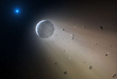 This artist's rendering provided by the Harvard-Smithsonian Center for Astrophysics shows an asteroid slowly disintegrating as it orbits a white dwarf star. On Wednesday, Oct. 21, 2015, researchers at the Harvard-Smithsonian Center for Astrophysics announced they have discovered a rocky object coming apart in a death spiral around a white dwarf star in the Constellation Virgo. They used NASA's Kepler spacecraft to make the discovery, then followed up with ground observations. (Mark A. Garlick/Harvard-Smithsonian Center for Astrophysics via AP)