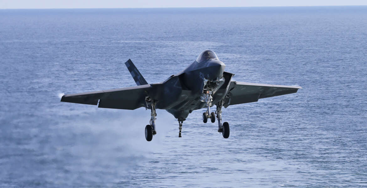 An F-35C Lightning II test aircraft approaches for a landing aboard the nuclear powered aircraft carrier USS Dwight D. Eisenhower of the coast of Norfolk, Va., Friday, Oct. 9, 2015.  The aircraft is expected to be deployed with the Navy in 2018.  (AP Photo/Steve Helber)