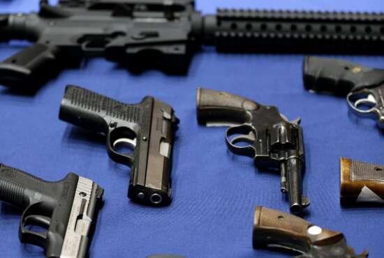 Guns seized by the police are displayed during a news conference in New York, Tuesday, Oct. 27, 2015. Officials announced charges in a gun trafficking case where more than 70 firearms were seized. (AP Photo/Seth Wenig)