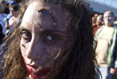 Josaphine Basile strolls down the Asbury Park Boardwalk during Zombie Walk in Asbury Park, N.J., Saturday, Oct. 10, 2015. Participants planned to make an extended walk through the city, then remain in the area for festivities that start once the sun goes down. (Doug Hood/The Asbury Park Press via AP)  NO SALES; MANDATORY CREDIT