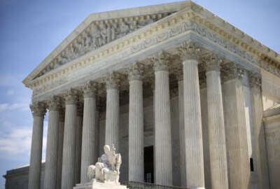 In this photo taken June 30, 2014, the Supreme Court building is seen in Washington. The Supreme Court seems divided over whether Internet search sites can be sued for publishing false information about people if the errors don't cause any real harm. The justices appeared to split along ideological lines Monday during arguments in a case that pits business groups concerned about exposure to costly litigation against consumer protection advocates who want companies held accountable for mistakes. (AP Photo/Pablo Martinez Monsivais)