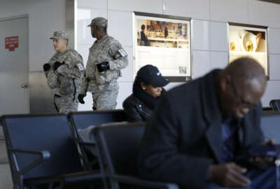 Security personnel walk round a terminal at LaGuardia Airport in New York, Wednesday, Nov. 25, 2015. An expanded version of America's annual Thanksgiving travel saga was under way Wednesday with gas prices low and terrorism fears high. An estimated 46.9 million Americans are expected to take a car, plane, bus or train at least 50 miles from home over the long holiday weekend, according to the motoring organization AAA. That would be an increase of more than 300,000 people over last year, and the most travelers since 2007. (AP Photo/Seth Wenig)