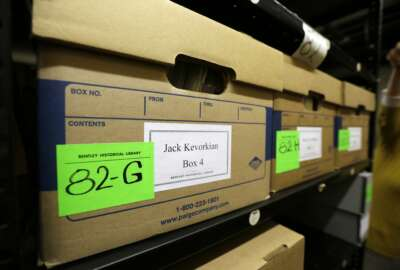In a photo from Thursday, Oct. 22, 2015, in Ann Arbor, Mich., boxes containing files on assisted suicide that belonged to Dr. Jack Kevorkian are stored at the Bentley Historical Library. The archive was donated by Ava Janus, Kevorkian's niece and sole heir. (AP Photo/Carlos Osorio)