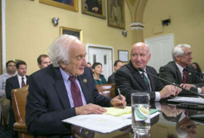 In this photo taken Dec. 10,2015, House Ways and Means Committee Chairman Rep. Kevin Brady, R-Texas, center, flanked by the committee's ranking member, Rep. Sander Levin, D-Mich., left, and  Rep. Dave Reichert, R-Wash., participate in a  House Rules Committee hearing on Capitol Hill in Washington. The House has approved a bill that would block U.S. negotiators from using trade agreements to cut greenhouse gas emissions.  (AP Photo/J. Scott Applewhite)