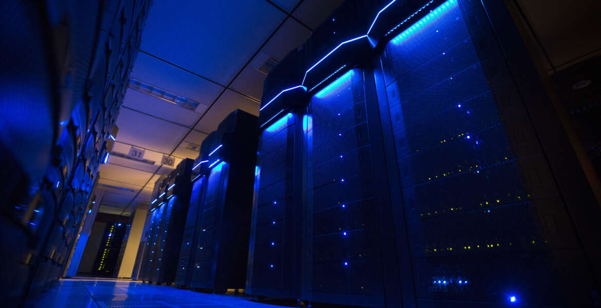 This Wednesday, May 20, 2015 photo shows server banks inside a data center at AEP headquarters in Columbus, Ohio. Like most big utilities, AEP's power plants, substations and other vital equipment are managed by a network that is separated from the company's business software with layers of authentication, and is not accessible via the Internet. Creating that separation, and making sure that separation is maintained, is among the most important things utilities can do to protect the grid's physical assets. (AP Photo/John Minchillo)