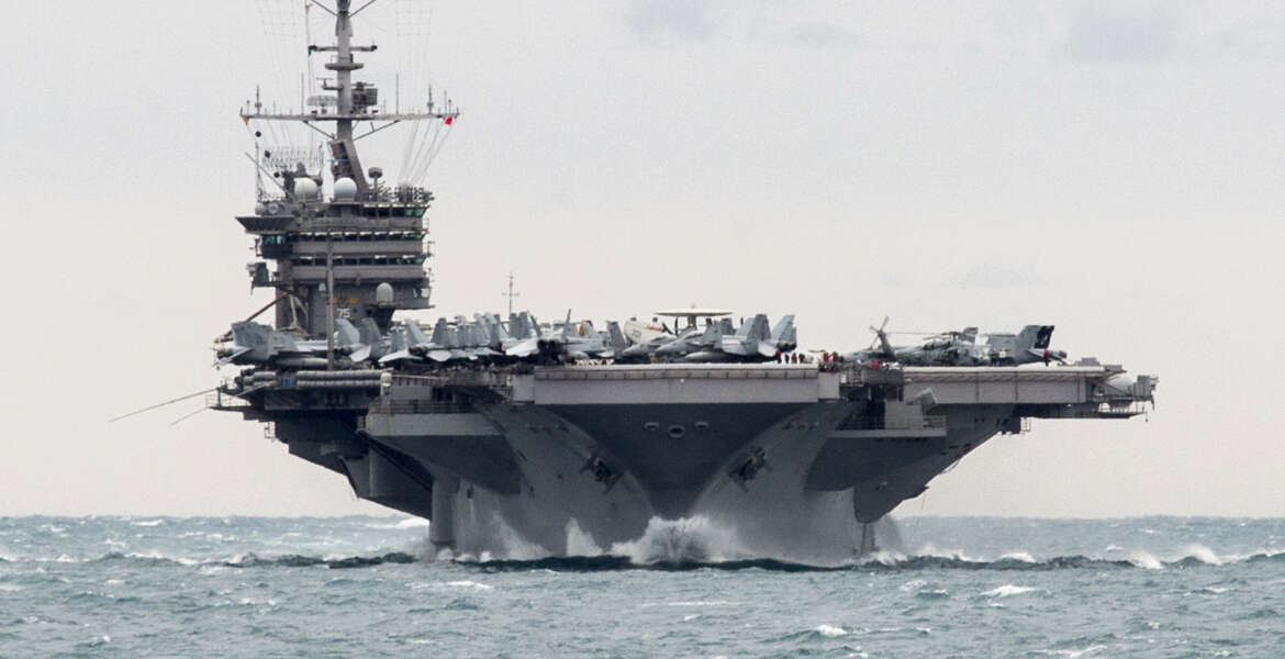 In this Saturday, Dec. 26, 2015 photo released by the U.S. Navy, the aircraft carrier USS Harry S. Truman transits the Strait of Hormuz. Iranian naval vessels conducted rocket tests last week near the USS Harry S. Truman aircraft carrier, the USS Bulkeley destroyer and a French frigate, the FS Provence, and commercial traffic passing through the Strait of Hormuz, the American military said Wednesday, Dec. 30, 2015 causing new tension between the two nations after a landmark nuclear deal. (Mass Communication Specialist 2nd Class M. J. Lieberknecht/U.S. Navy via AP) MANDATORY CREDIT