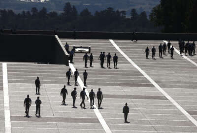 FILE - In this Aug. 13, 2014, file photo, cadets walk between classes on the Air Force Academy campus, near Colorado Springs, Colo. Reports of sexual assaults at the three military academies surged by more than 50 percent in the 2014-15 school year, and complaints of sexual harassment also spiked, according to Pentagon officials. (AP Photo/Brennan Linsley, File)