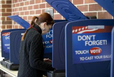 A woman casts her ballot in the South Carolina Republican Presidential Primary Saturday, Feb. 20, 2016, in Columbia, S.C. (AP Photo/John Bazemore)