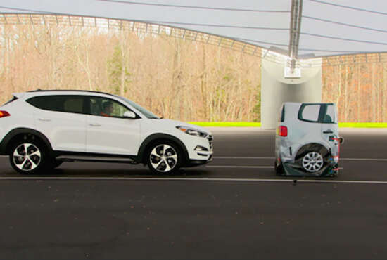 In this frame grab from video provided by the  Insurance Institute for Highway Safety (IIHS), taken in 2015, a vehicle closes in on a Strikeable Surrogate Vehicle (SSV) at the IIHS Vehicle Research Center in Ruckersville, Va. Federal regulators and the auto industry are taking a more lenient approach than safety advocates would like to phasing in automatic braking systems for passenger cars, according to the official records of their closed-door negotiations. Systems that automatically apply brakes to prevent or mitigate collisions, rather than waiting for the driver to act, are the most important safety technology available today that's not already required in cars. (Insurance Institute for Highway Safety via AP)