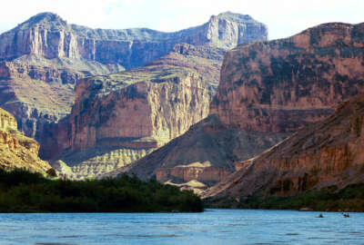 FILE - This Aug. 29, 2002 file photo, shows the Colorado River at the Grand Canyon National Park, in Arizona. The National Park Service has outlined a series of actions in response to a federal report that found employees at the Grand Canyon preyed on their female colleagues and retaliated against them for refusing sexual advances. The agency's Intermountain Region director, Sue Masica, said employees will be disciplined appropriately and she will push a message of zero tolerance for sexual harassment and hostile work environments.(AP Photo/Brian Witte, File)