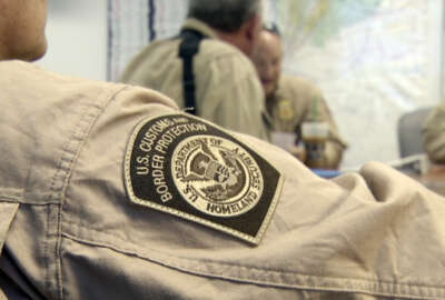 U.S. Customs and Border Protection agents attend a briefing in Jacksonville, Fla. (AP Photo/Joshua Replogle)