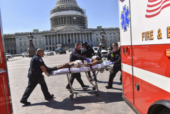 EDS NOTE: The suspect's face was digitally altered by the Washington Post at the request of the Washington D.C. Fire and EMS Department. First responders transport the person believed to be the suspect in a shooting at the U.S. Capitol complex Monday, March 28, 2016, in Washington. Visitors and staff were shut in their offices and told to
