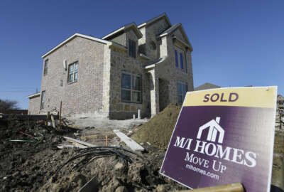 In this Tuesday, Feb. 2, 2016, photo, a sold sign sits next to a house under the final stages of construction in Plano, Texas. On Thursday, March 10, 2016, Freddie Mac reports on the week's average U.S. mortgage rates. (AP Photo/LM Otero)