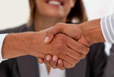 Close-up of successful businessmen closing a deal