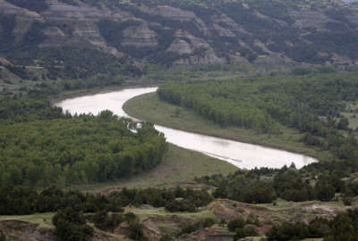 FILE In this June 11, 2014 file photo, the Little Missouri River winds it's way inside the Theodore Roosevelt National Park located in the Badlands of North Dakota, atop the Bakken shale, an oil-rich rock formation. A new study has found that a single oil and gas field in the western U.S. is responsible for a global uptick of the air pollutant ethane. The research team found that fossil fuel production at the Bakken Formation located in North Dakota and Montana is emitting roughly 2 percent of the ethane detected in the Earth's atmosphere. Ethane reacts with sunlight to form ozone, which triggers respiratory problems.  (AP Photo/Charles Rex Arbogast, File)