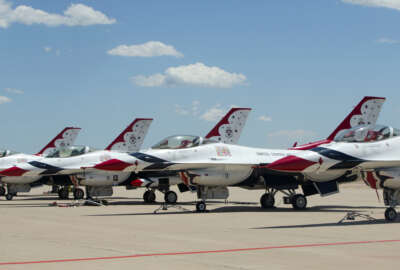 Air Force Thunderbird jets sit on the tarmac at Peterson Air Base, Colo., Thursday, June 2, 2016. An Air Force Thunderbird jet crashed Thursday in Colorado just after a flyover at a graduation ceremony for Air Force Academy cadets where President Barack Obama had spoken. (AP Photo/Pablo Martinez Monsivais)