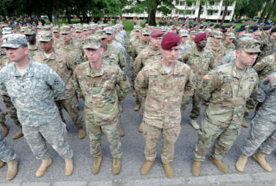 U.S. Army soldiers representing units participating in the the Anaconda-16 military exercise, attend the opening ceremony, in Warsaw, Poland, Monday, June 6, 2016. Poland and some NATO members are launching their biggest ever exercise, involving some 31,000 troops, as central and eastern European nations are seeking strong security guarantees among concerns about Russia's assertiveness and actions. .(AP Photo/Alik Keplicz)