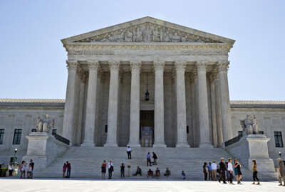 FILE - In this June 20, 2016 file photo, the Supreme Court is seen in Washington. The Supreme Court is set to close out its current term with opinions Monday in three remaining three cases after a flurry of decisions last week. It's expected to be the justices' final meeting before they disperse on their summer breaks. (AP Photo/Alex Brandon, File)