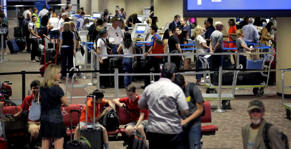FILE - In this May 27, 2016 file photo, passengers line up to check in before their flight at Sky Harbor International Airport in Phoenix. Significant progress has been made on shortening screening lines since earlier this spring when airlines reported thousands of frustrated passengers were missing flights, the head of the Transportation Security Administration said Tuesday, June 7, 2016. (AP Photo/Matt York, File)