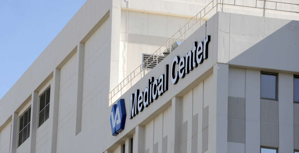 FILE-- This April 28, 2014 file photo shows the Phoenix VA Health Care Center in Phoenix.   Sharon Helman, the former director of the Phoenix VA Health Care System, is suing the Department of Veterans Affairs to win her old job back. Helman argues in court papers that a key portion of a 2014 law passed in response to the wait-time scandal is unconstitutional and denies her right to appeal her firing. Attorney General Loretta Lynch says in a letter to Congress that the Justice Department has decided not to contest that element of Helman's challenge, essentially agreeing with her legal position. Lynch says Justice will continue fighting against Helman's reinstatement.   (AP Photo/Ross D. Franklin, File)