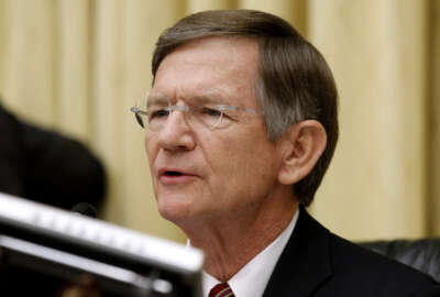 FILE - In this June 7, 2012 file photo,  House Science Committee Chairman Rep. Lamar Smith, R-Texas speaks on Capitol Hill in Washington. Escalating a political fight over global warming, Smith issued subpoenas Wednesday, July 13, 2016, to two Democratic state attorneys general, seeking records about their investigation into whether Exxon Mobil misled investors about global warming. (AP Photo/Charles Dharapak, File)