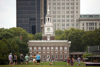 FILE - In this July 30, 2015 file photo, visitors walk in view of Independence Hall in Philadelphia. Democrats are set to begin their convention at the end of July 2016 in a city that symbolizes both the nation's promise and its shortcomings. (AP Photo/Matt Rourke, File)