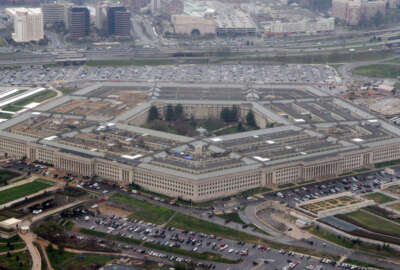 """FILE - The Pentagon is seen in this aerial view in Washington, in this March 27, 2008 file photo. The Pentagon has revised its Law of War guidelines to remove wording that could permit U.S. military commanders to treat war correspondents as """"unprivileged belligerents"""" if they think the journalists are sympathizing or cooperating with enemy forces. The amended manual, published on July 22, 2016, also drops wording that equated journalism with spying. (AP Photo/Charles Dharapak, File)"""