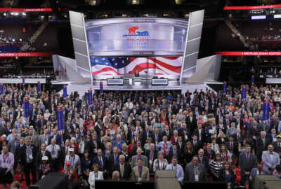 Delegates stand and turn toward the camera for the official photo during the opening day of the Republican National Convention in Cleveland, Monday, July 18, 2016. (AP Photo/J. Scott Applewhite)