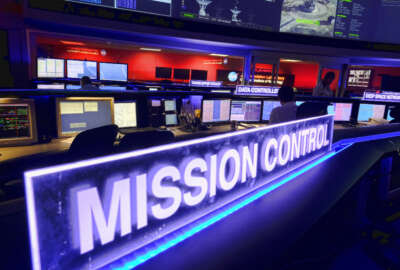 Data Controller Nick Lam, monitors the Juno spacecraft inside Mission Control in the Space Flight Operations Facility at Jet Propulsion Laboratory, in Pasadena, Calif., Monday, July 4, 2016. NASA's Juno spacecraft will fire its main rocket engine late Monday to slow itself down from a speed of 150,000 mph (250,000 kph) and slip into orbit around Jupiter. The solar-powered spacecraft is spinning toward Jupiter for the closest encounter with the biggest planet in our solar system. (AP Photo/Richard Vogel)