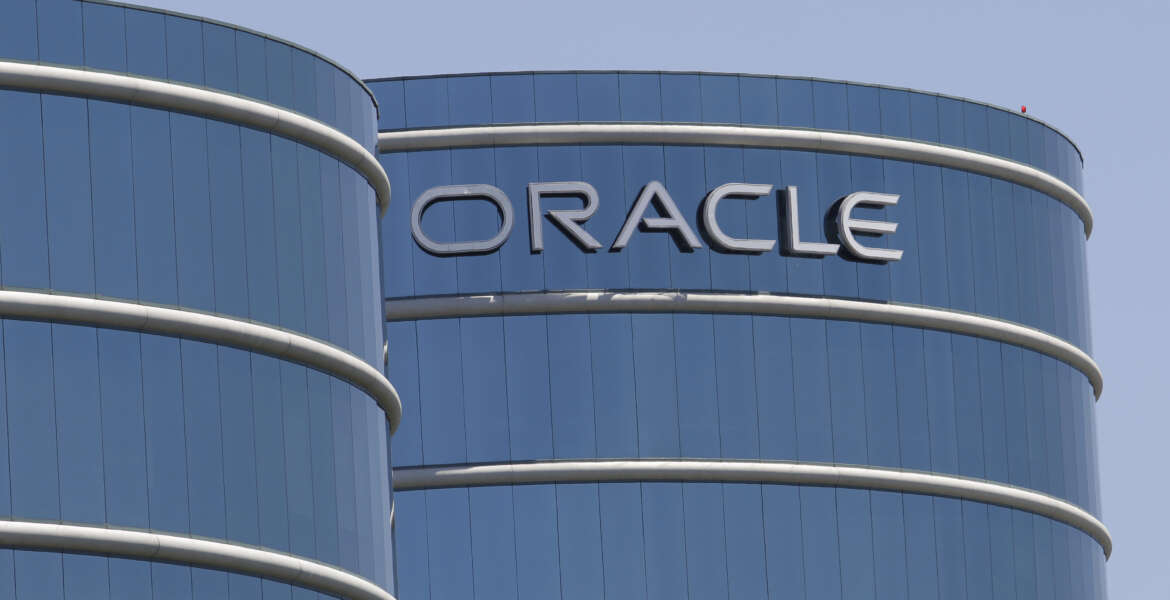 FILE - This Monday, June 18, 2012, file photo shows Oracle headquarters in Redwood City, Calif. Oracle is buying cloud company NetSuite in a deal valued at about $9.3 billion. Oracle CEO Mark Hurd said in a statement on Thursday, July 28, 2016, that the two company's cloud applications are complementary.