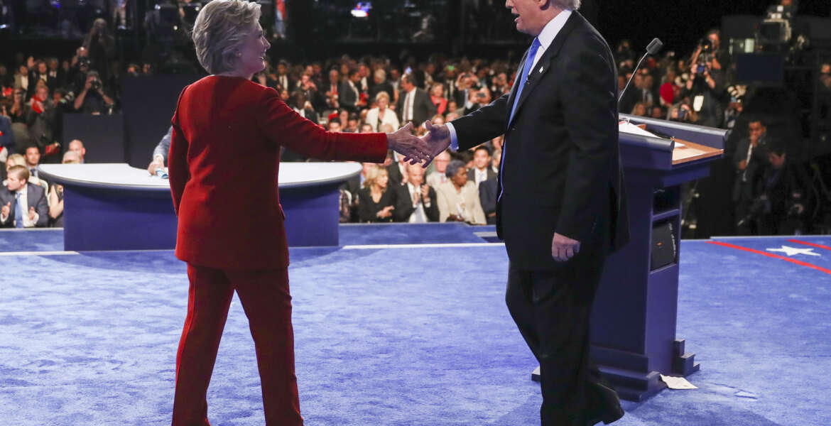 Democratic presidential nominee Hillary Clinton shakes hands with Republican presidential nominee Donald Trump after the presidential debate at Hofstra University in Hempstead, N.Y., Monday, Sept. 26, 2016. (Joe Raedle/Pool via AP)