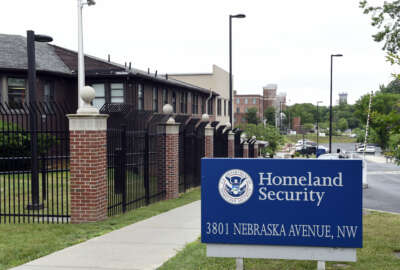FILE - In this June 5, 2015 file photo, a view of the Homeland Security Department headquarters in Washington. The U.S. government has mistakenly granted citizenship to at least 858 immigrants who had pending deportation orders from countries of concern to national security or with high rates of immigration fraud, according to an internal Homeland Security audit released Monday, Sept. 19, 2016. The Homeland Security Department's inspector general found that the immigrants used different names or birthdates to apply for citizenship with U.S. Citizenship and Immigration Services and such discrepancies weren't caught because their fingerprints were missing from government databases.  (AP Photo/Susan Walsh, File)