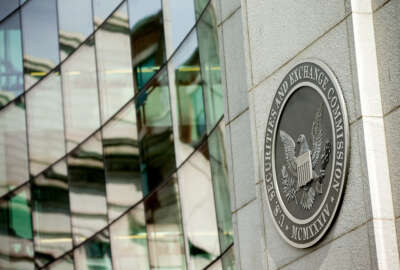 This Friday, June 19, 2015, photo shows the U.S. Securities and Exchange Commission building, in Washington. On Wednesday, Sept. 21, 2016, the SEC announced civil insider-trading charges against high-profile hedge fund manager Leon Cooperman and his firm, Omega Advisors. Cooperman is accused of illegally trading on confidential information he learned from a company executive. (AP Photo/Andrew Harnik)