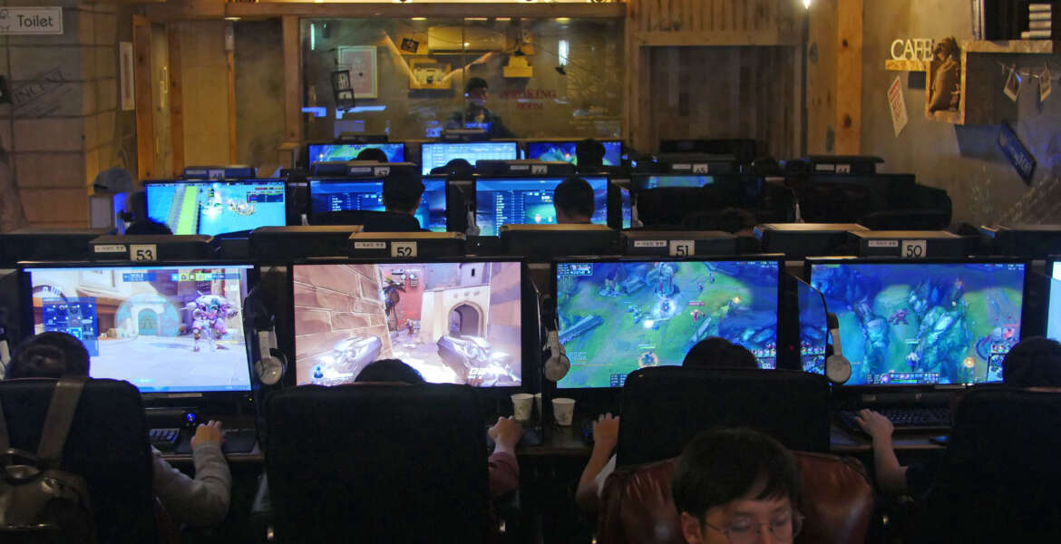 In this Aug. 30, 2016 photo, people play computer games at a PC cafe in Seoul, South Korea. South Korea has the biggest e-Sports industry in the world with professional leagues and broadcasting channels. South Korea started the e-sports industry in the early 2000s, and it continues to be a world leader in competitive gaming. There are not only professional video game players, but also broadcasting channels and professional leagues for different kinds of games. South Koreans can easily watch professional gamers playing on both television and the internet. (AP Photo/Jungho Choi)