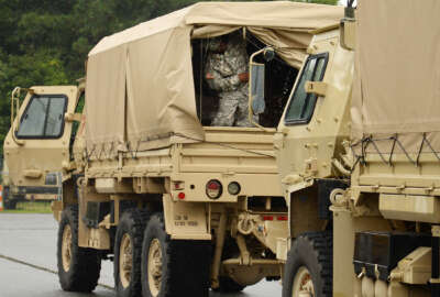 The North Carolina National Guard prepares to depart their Kinston, N.C., yard Friday, Sept. 2, 2016, to stage at the Global Transpark after being activated head of Tropical Storm Hermine. (Zach Frailey/Daily Free Press via AP)