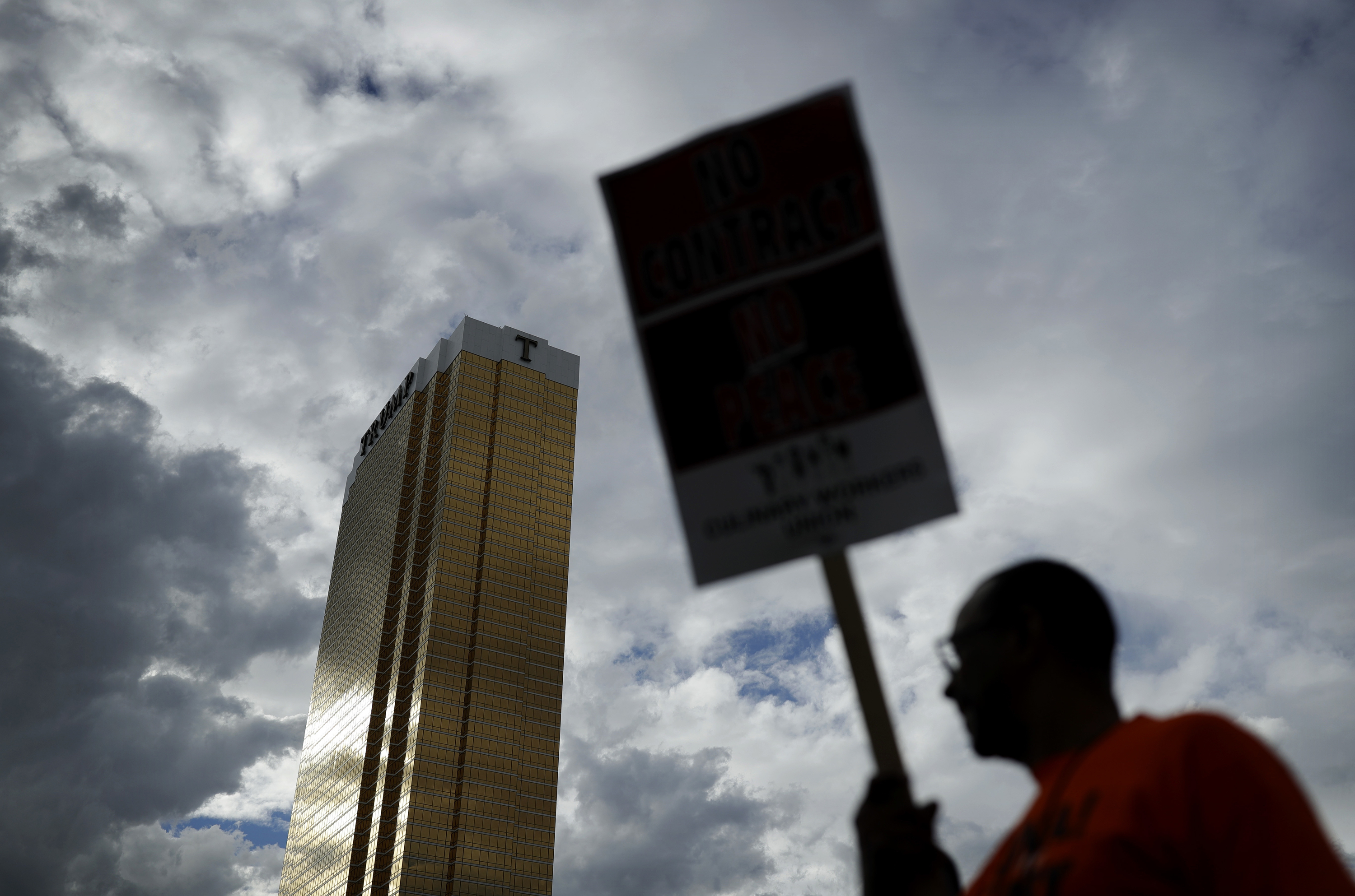 FILE - In this Sept. 21, 2016 file photo Laborers' International Union of North America members and Culinary Union members protest outside of the Trump International hotel in Las Vegas. Inflamed by Trump's candidacy, organized labor groups including the heavily immigrant Culinary Union are in the thick of an aggressive get-out-the-vote campaign in Nevada. The election comes just as the Culinary Union engages in a labor dispute with management at Trump's Las Vegas hotel, adding more ammunition to their campaign against him. (AP Photo/John Locher, File)