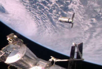 This photo provided by NASA TV shows the Cygnus resupply ship, above, slowly approaching the International Space Station before the Canadarm2 reaches out and grapples it, Sunday, Oct. 23, 2016. Once the Cygnus is unloaded, it will be filled with trash and set loose to burn up in the atmosphere in mid-November. (NASA TV via AP)