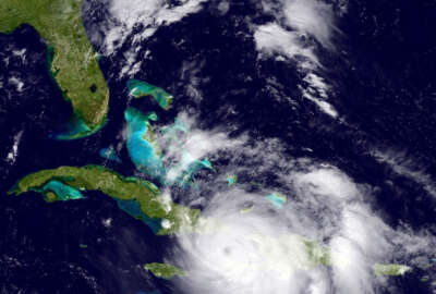 The GOES East satellite image provided by the National Oceanic and Atmospheric Administration (NOAA) and taken Tuesday, Oct. 4, 2016 at 1:12 p.m. EDT, shows Hurricane Matthew over the Caribbean region.  Hurricane Matthew roared across the southwestern tip of Haiti with 145 mph winds Tuesday, Oct. 4, 2016, uprooting trees and tearing roofs from homes in a largely rural corner of the impoverished country as the storm headed north toward Cuba and the east coast of Florida. (NOAA via AP)