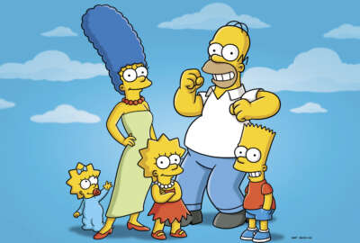 This undated publicity photo released by Fox, shows, from left, from left, Maggie, Marge, Lisa, Homer and Bart  from the animated series,