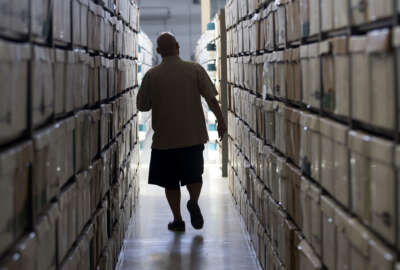 In this photo taken Monday, July 18, 2016, boxes of California inmate medical records are stored at a facility in Sacramento, Calif. A massive project to computerize the prison system's antiquated paper-based medical record-keeping for the nearly 130,000 inmates has doubled in cost from the original estimates to nearly $400 million. (AP Photo/Rich Pedroncelli)