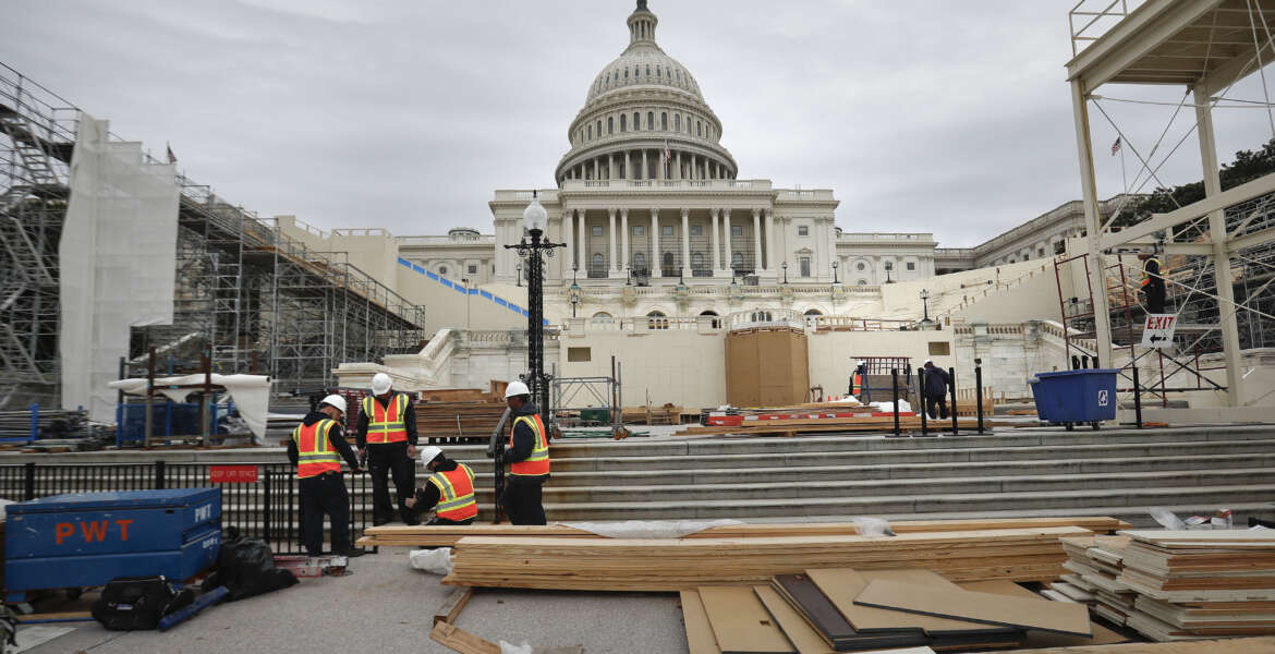 Construction continues on the Inaugural platform in preparation for the Inauguration and swearing-in ceremonies for President-elect Donald Trump, Thursday, Dec. 8, 2016, on the Capitol steps in Washington. Trump will be sworn in a president on Jan. 20, 2017. (AP Photo/Pablo Martinez Monsivais)