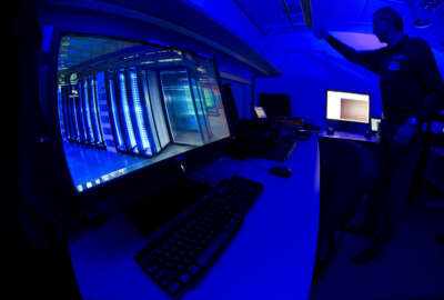 FILE - This is a Friday Jan. 11, 2013 file photo of a member of the Cybercrime Center as he turns on the light in a lab during a media tour at the occasion of the official opening of the Cybercrime Center at Europol headquarters in The Hague, Netherlands. Europol said Thursday Dec. 1, 2016, that five arrests have been made in connection with a massive operation aimed at knocking out a cybercrime group accused of inflicting hundreds of millions of euros in losses worldwide.   (AP Photo/Peter Dejong, File)