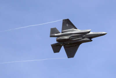 FILE - In this Wednesday, Sept. 2, 2015, file photo, an F-35 jet arrives at its new operational base at Hill Air Force Base, in northern Utah. Shares of Lockheed Martin fell Monday, Dec. 12, 2016, as President-elect Donald Trump tweeted that making F-35 fighter planes is too costly and that he will cut